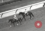 Image of horse racing United States USA, 1964, second 7 stock footage video 65675063245