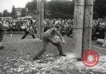 Image of tree-chopping and sawing contest Bavaria Germany, 1967, second 7 stock footage video 65675063266