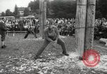 Image of tree-chopping and sawing contest Bavaria Germany, 1967, second 8 stock footage video 65675063266