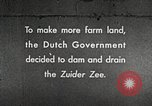Image of dam on Zuider Zee Netherlands, 1940, second 1 stock footage video 65675063271