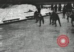 Image of Ice skating races outdoors on a flooded stadium ice rink during winter United States USA, 1900, second 1 stock footage video 65675063386