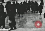 Image of Ice skating races outdoors on a flooded stadium ice rink during winter United States USA, 1900, second 12 stock footage video 65675063386