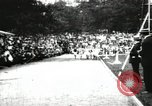 Image of Amateur runners compete in races at a stadium in the United States United States USA, 1900, second 11 stock footage video 65675063387