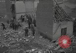 Image of bomb destroyed building Spain, 1945, second 9 stock footage video 65675063415