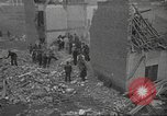 Image of bomb destroyed building Spain, 1945, second 10 stock footage video 65675063415
