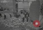 Image of bomb destroyed building Spain, 1945, second 12 stock footage video 65675063415