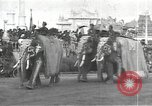 Image of Procession with decorated elephant Bombay India, 1932, second 2 stock footage video 65675063442