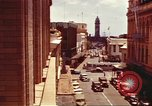Image of Street scenes with buildings, traffic, and Aloha Tower in distance Honolulu Hawaii USA, 1942, second 2 stock footage video 65675063478