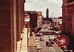 Image of Street scenes with buildings, traffic, and Aloha Tower in distance Honolulu Hawaii USA, 1942, second 3 stock footage video 65675063478
