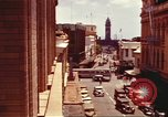 Image of Street scenes with buildings, traffic, and Aloha Tower in distance Honolulu Hawaii USA, 1942, second 5 stock footage video 65675063478