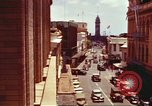 Image of Street scenes with buildings, traffic, and Aloha Tower in distance Honolulu Hawaii USA, 1942, second 11 stock footage video 65675063478