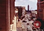 Image of Street scenes with buildings, traffic, and Aloha Tower in distance Honolulu Hawaii USA, 1942, second 12 stock footage video 65675063478