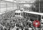 Image of trolleys outside factory United States USA, 1918, second 1 stock footage video 65675063746