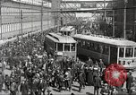 Image of trolleys outside factory United States USA, 1918, second 3 stock footage video 65675063746