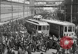 Image of trolleys outside factory United States USA, 1918, second 4 stock footage video 65675063746