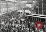 Image of trolleys outside factory United States USA, 1918, second 8 stock footage video 65675063746
