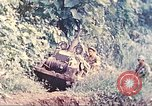 Image of US 5th Marines use winch to pull armored vehicle uphill Talasea New Britain, 1944, second 5 stock footage video 65675063814