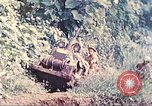 Image of US 5th Marines use winch to pull armored vehicle uphill Talasea New Britain, 1944, second 6 stock footage video 65675063814