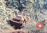 Image of US 5th Marines use winch to pull armored vehicle uphill Talasea New Britain, 1944, second 7 stock footage video 65675063814