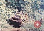 Image of US 5th Marines use winch to pull armored vehicle uphill Talasea New Britain, 1944, second 8 stock footage video 65675063814