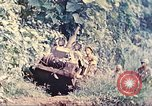 Image of US 5th Marines use winch to pull armored vehicle uphill Talasea New Britain, 1944, second 9 stock footage video 65675063814