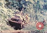 Image of US 5th Marines use winch to pull armored vehicle uphill Talasea New Britain, 1944, second 10 stock footage video 65675063814