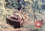 Image of US 5th Marines use winch to pull armored vehicle uphill Talasea New Britain, 1944, second 11 stock footage video 65675063814