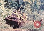 Image of US 5th Marines use winch to pull armored vehicle uphill Talasea New Britain, 1944, second 12 stock footage video 65675063814