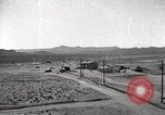 Image of Operation Cue debris flying Nevada United States USA, 1955, second 6 stock footage video 65675063881