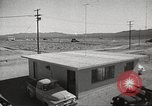 Image of Operation Cue effects on house and telephone poles Nevada United States USA, 1955, second 6 stock footage video 65675063885