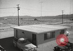 Image of Operation Cue effects on house and telephone poles Nevada United States USA, 1955, second 8 stock footage video 65675063885