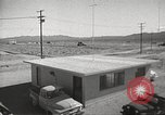Image of Operation Cue effects on house and telephone poles Nevada United States USA, 1955, second 9 stock footage video 65675063885