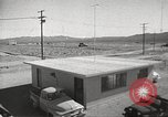 Image of Operation Cue effects on house and telephone poles Nevada United States USA, 1955, second 10 stock footage video 65675063885
