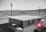 Image of Operation Cue effects on house and telephone poles Nevada United States USA, 1955, second 11 stock footage video 65675063885
