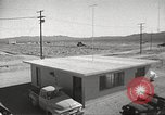 Image of Operation Cue effects on house and telephone poles Nevada United States USA, 1955, second 12 stock footage video 65675063885