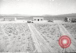 Image of House and cars in Operation Cue nuclear test Nevada United States USA, 1955, second 1 stock footage video 65675063891
