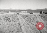 Image of House and cars in Operation Cue nuclear test Nevada United States USA, 1955, second 3 stock footage video 65675063891