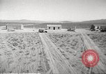 Image of House and cars in Operation Cue nuclear test Nevada United States USA, 1955, second 4 stock footage video 65675063891