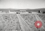 Image of House and cars in Operation Cue nuclear test Nevada United States USA, 1955, second 5 stock footage video 65675063891