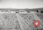 Image of House and cars in Operation Cue nuclear test Nevada United States USA, 1955, second 6 stock footage video 65675063891