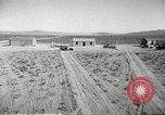 Image of House and cars in Operation Cue nuclear test Nevada United States USA, 1955, second 8 stock footage video 65675063891