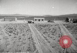 Image of House and cars in Operation Cue nuclear test Nevada United States USA, 1955, second 9 stock footage video 65675063891