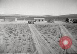 Image of House and cars in Operation Cue nuclear test Nevada United States USA, 1955, second 10 stock footage video 65675063891