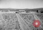 Image of House and cars in Operation Cue nuclear test Nevada United States USA, 1955, second 11 stock footage video 65675063891