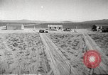 Image of House and cars in Operation Cue nuclear test Nevada United States USA, 1955, second 12 stock footage video 65675063891