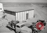 Image of Operation Cue nuclear testing staff and test house  Nevada United States USA, 1955, second 3 stock footage video 65675063895