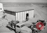 Image of Operation Cue nuclear testing staff and test house  Nevada United States USA, 1955, second 7 stock footage video 65675063895