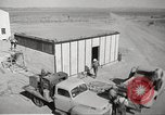 Image of Operation Cue nuclear testing staff and test house  Nevada United States USA, 1955, second 8 stock footage video 65675063895