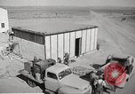 Image of Operation Cue nuclear testing staff and test house  Nevada United States USA, 1955, second 10 stock footage video 65675063895