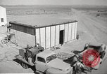 Image of Operation Cue nuclear testing staff and test house  Nevada United States USA, 1955, second 12 stock footage video 65675063895